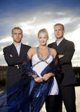 Beautiful woman and her bodyguards Stock Photo