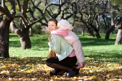 Beautiful woman with her child on back Royalty Free Stock Photos