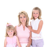 Beautiful Woman With Her Daughters Over White stock image