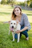 Beautiful woman with her dog. Labrador retriever Stock Photos