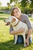 Beautiful woman with her dog. Labrador retriever Royalty Free Stock Photo