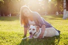 Beautiful woman with her dog. Labrador retriever Stock Photography