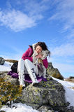Beautiful woman and her dog in the mountain Royalty Free Stock Images