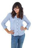 Beautiful woman with her hands on hips and wearing glasses Stock Image