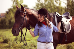 Beautiful woman with her horse Stock Image