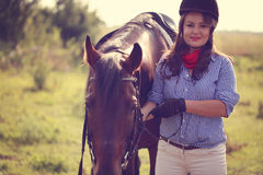 Beautiful woman with her horse Royalty Free Stock Photography