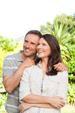 Beautiful woman with her husband in the garden Stock Photography
