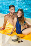 Beautiful woman with her husband at the pool. stock photography