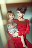 Beautiful woman with her joyful daughter Stock Image