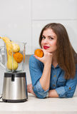 Beautiful woman at her kitchen Royalty Free Stock Photos