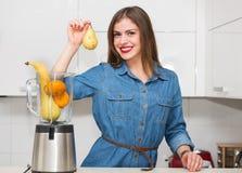 Beautiful woman at her kitchen Stock Photos