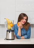 Beautiful woman at her kitchen Stock Photography