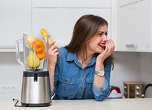 Beautiful woman at her kitchen Royalty Free Stock Images