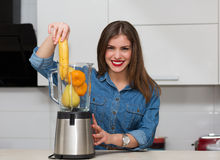 Beautiful woman at her kitchen Stock Image