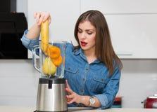 Beautiful woman at her kitchen Stock Photo
