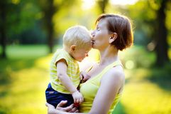 Beautiful  woman and her little grandson at sunny park Royalty Free Stock Image