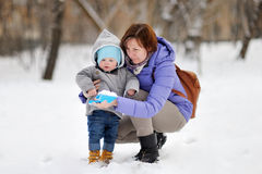 Beautiful woman and her little grandson at the winter Royalty Free Stock Image