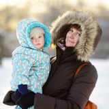 Beautiful woman and her little grandson at the winter Royalty Free Stock Photography