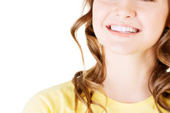 Beautiful woman with her perfect straight white teeth. Stock Photos