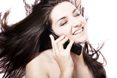 Beautiful woman on her phone Stock Photography