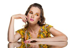 Beautiful woman and her reflection in mirror table Stock Images