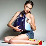Beautiful woman in high heels holds handbag. stock photos