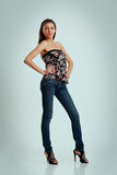 Beautiful woman in high heels and jeans Royalty Free Stock Images