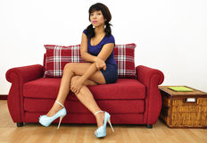 Beautiful woman high heels short dress legs crossed Stock Image