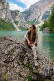 Beautiful woman hiker near wild mountain lake.  Royalty Free Stock Photo