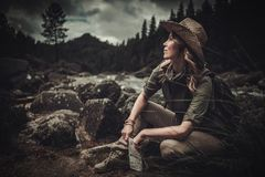 Beautiful woman hiker near wild mountain river. Stock Images