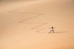 Beautiful woman hiking on giant sand dunes. Liwa desert, UAE Royalty Free Stock Photography
