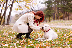 Beautiful woman and his dog Royalty Free Stock Photography