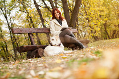 Beautiful woman and his dog (Labrador retriever) relaxing in park Stock Photo