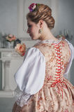 Beautiful woman in historic medieval dress. Back pose Stock Images