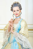 Beautiful woman in historical dress in Baroque style in the inte. Rior royalty free stock images