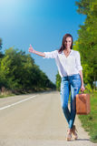 Beautiful woman hitchhiking Stock Photo