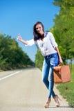 Beautiful woman hitchhiking Royalty Free Stock Photography