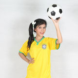 Beautiful woman hold ball over her head with wearing Brazil foot Stock Image