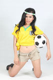 Beautiful woman hold ball with wearing Brazil football top Stock Photography