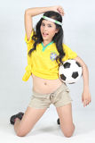 Beautiful woman hold ball with wearing Brazil football top Stock Image