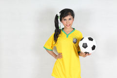 Beautiful woman hold ball with wearing Brazil football top Royalty Free Stock Photos
