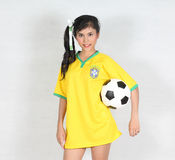 Beautiful woman hold ball with wearing Brazil football top Royalty Free Stock Photography