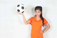 Beautiful woman hold ball with wearing football top Royalty Free Stock Image