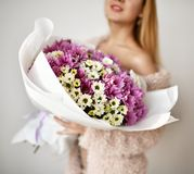 Beautiful woman hold bouquet of chrysanthemum flowers white and purple happy smiling Royalty Free Stock Photos
