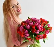 Beautiful Woman Hold Bouquet Of Red And Pink Tulip Flowers Happy Smiling On Grey Stock Photography