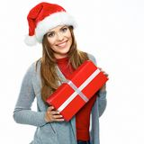 Beautiful woman hold gift. Santa hat. Christmass girl portrait. White background Stock Images