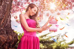 Beautiful woman - hold hands birdcage - surrounded by a lot of butterflies Royalty Free Stock Photography
