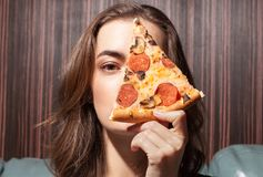Young gorgeous female with pizza royalty free stock images