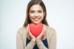 Beautiful woman hold red heart. Valentine day love concept. Isolated portrait on white background. Smile with teeth royalty free stock photos