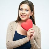 Beautiful woman hold red heart. Valentine day love concept. Isolated portrait on white background. Smile with teeth stock photography